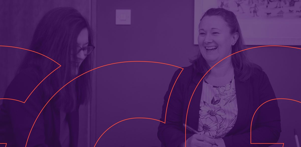 women laughing at work with a purple overlay