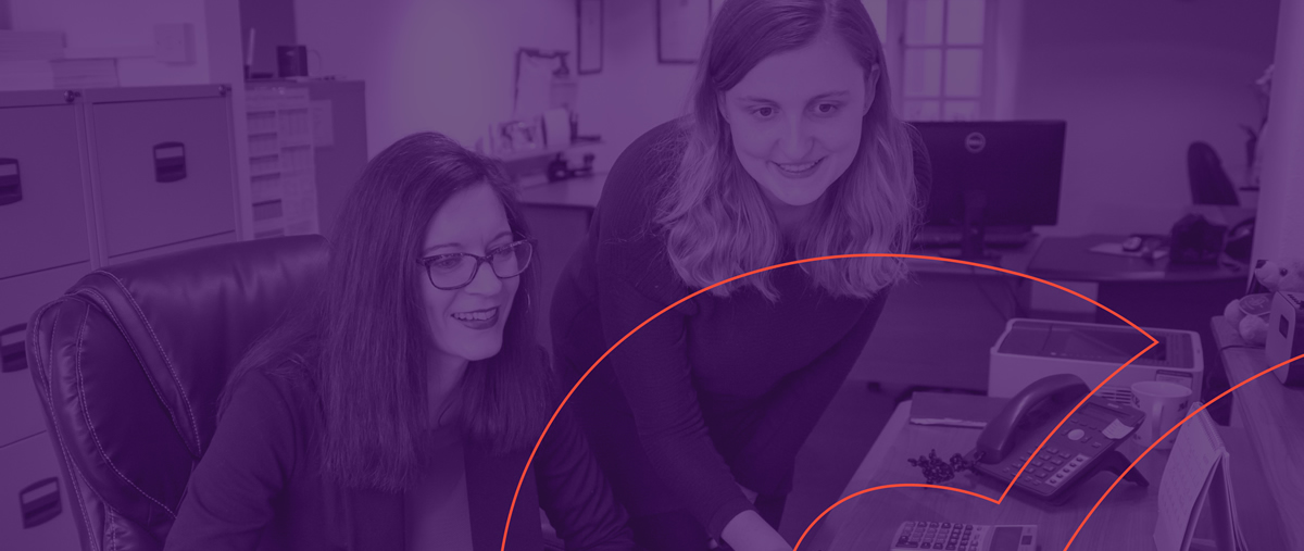 professional women at desk with purple overlay